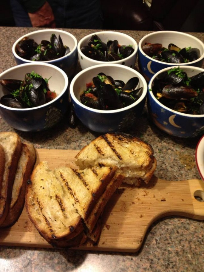 Gypsy Mussels with kalamata olives, Mad Pickler's hot peppers, tomato, garlic and grilled Orchard Hill Country Loaf