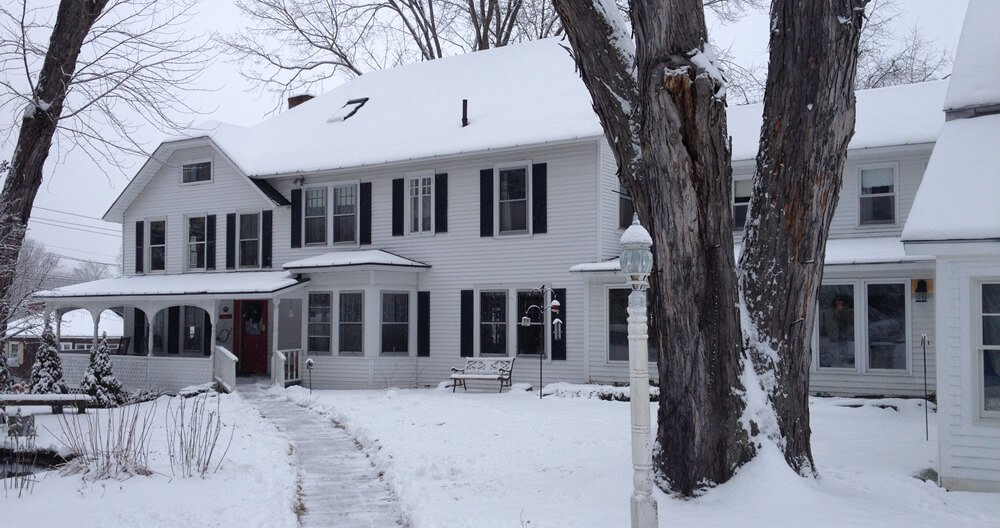 Picture of the home with snow.