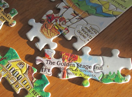 puzzle pieces partially connected with the words The Golden Stage Inn on one area